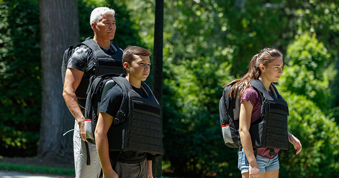 family with bulletproof backpack deployed